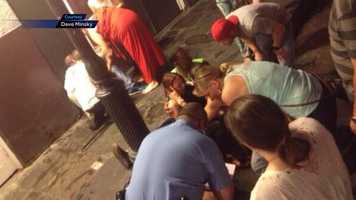 A witness of the mass shooting on Bourbon Street captured the aftermath on his cell phone. (WARNING: Images may be too graphic for some viewers)A photo of one of the victims who suffered a graze wound to her face. Several bystanders stand nearby, helping the victim.