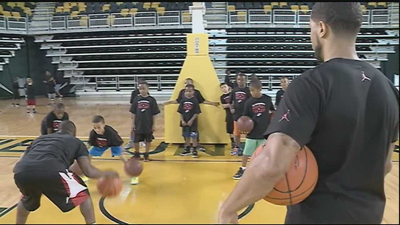 NBA star DJ Augustin comes home to New Orleans to run free basketball camp.