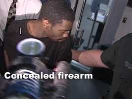 Bradley, 22, was also arrested over a concealed firearm, officials said.