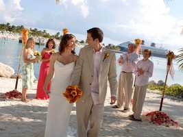 If you're bringing a larger group on a cruise, the perfect spot for a ceremony is the beach at Castaway Cay, Disney's private island in the Bahamas.  The beach can accommodate up to 100 guests.  The cruise ship dock, blue water and white sand serve as your backdrop.