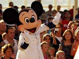 The blue blazer may be his favorite, but Mickey has been pictured in a white sailing suit, too.