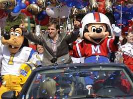 Mickey dons a football jersey and helmet for to celebrate the Saints' Super Bowl win with Drew Brees.