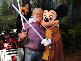 Mickey dresses as Luke Skywalker for his photo with the Star Wars creator himself, George Lucas.