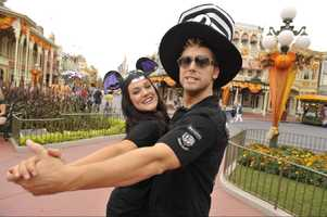 "Singer and actor Lance Bass (right) and his ""Dancing with the Stars"" professional dance partner Lacey Schwimmer (left) get into the Halloween spirit Oct. 23, 2008 in the Magic Kingdom at Walt Disney World in Lake Buena Vista, Fla."