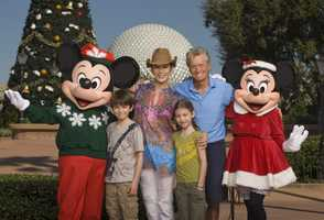Catherine Zeta-Jones and Michael Douglas pose with their children, Dylan (left), age 10, and Carys (right), age 7, on Nov. 24, 2010, along with Mickey Mouse and Minnie Mouse in front of the Epcot theme park Christmas tree in Lake Buena Vista, Fla.