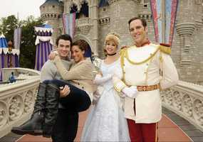 "To celebrate their first wedding anniversary, Kevin Jonas of the pop trio ""Jonas Brothers"" and his wife Danielle pose Dec. 19, 2010 in front of Cinderella Castle with Cinderella and Prince Charming at the Magic Kingdom in Lake Buena Vista, Fla."