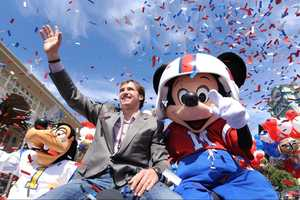 Super Bowl XLIV MVP Drew Brees joins Mickey Mouse Feb. 8, 2010 in a celebratory parade in the Magic Kingdom in Lake Buena Vista, Fla.