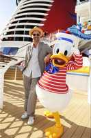 "Actor John Stamos poses Jan. 19, 2011 with a nautical-themed Donald Duck aboard the new ""Disney Dream"" cruise ship."