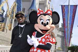 "Hip-hop artist Big Boi, one-half of the Grammy Award-winning duo ""OutKast,"" poses July 24, 2009 with Minnie Mouse at the Magic Kingdom in Lake Buena Vista, Fla."