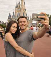 Actor Brian Austin Green (right) and his wife, actress/model Megan Fox (left), take a souvenir photo Nov. 26, 2010 in the Magic Kingdom in Lake Buena Vista, Fla.