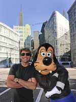 Singer Jon Bon Jovi poses with Goofy Nov. 16, 2009 on the New York Street backlot set at Disney's Hollywood Studios theme park at Walt Disney World Resort in Lake Buena Vista, Fla.