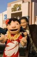 "Actor Daniel Dae Kim, star of the ABC series ""Lost"" and currently starring on the new CBS series ""Hawaii Five-0,"" poses Dec. 28, 2010 with Lilo from Disney's animated film ""Lilo and Stitch"" at Disney's Hollywood Studios in Lake Buena Vista, Fla."