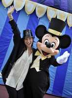 Actress Brittany Snow celebrates New Year's Eve at the Magic Kingdom with Mickey Mouse on Dec. 31, 2008.