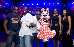 Grammy-Award winning R&B group Boyz II Men (L-R) Nathan Morris, Shawn Stockman and Wanya Morris pose Nov. 1, 2010 with Minnie Mouse (center), Essence Magazine's editor-in-chief Angela Burt-Murray (second from right) and Essence Communications I