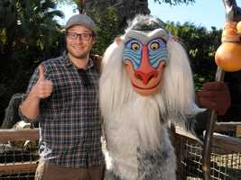 "Actor, comedian and animated film voice actor Seth Rogen poses with Disney's character Rafiki, from ""The Lion King,"" Nov. 26, 2011 at Disney's Animal Kingdom theme park at Walt Disney World Resort in Lake Buena Vista, Fla."