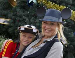 Actress and activist Maria Bello with her son, Jackson, in front of the holiday tree at Epcot theme park at Walt Disney World Resort in Lake Buena Vista, Fla.