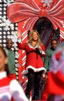 "Grammy Award-winning singer Mariah Carey performs Dec. 3, 2010 at the Magic Kingdom in Lake Buena Vista, Fla., while taping the ""Disney Parks Christmas Day Parade"" TV special."