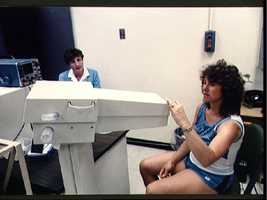 Teacher Christa McAuliffe prepare to test her lung capacity