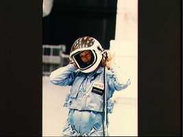 Christa McAuliffe removing helmet after egress training