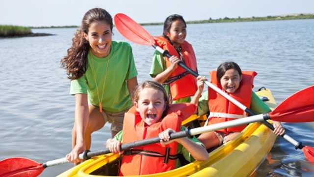 Girls canoeing, camp