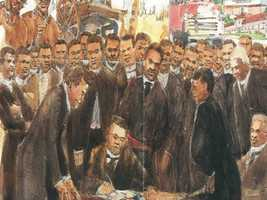 A painting of that depicts the signing of town charter on August 18, 1887.