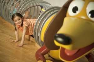 Children can crawl through Slinky Dog  while playing in the Toy Story-inspired room.