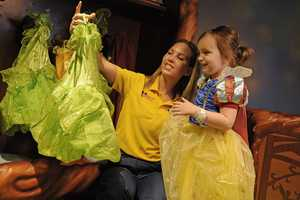 In Pixie Hollow, children can dress up in costumes and make crafts while sitting on acorns and mushrooms.