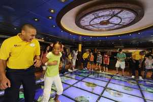 The Magic PlayFloor aboard Disney Dream and Disney Fantasy allows young cruisers to use group work to control the action.