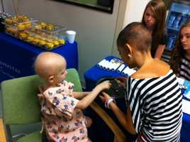 Talia Castellano gave makeovers to patients at Arnold Parmer Children's Hospital Monday.