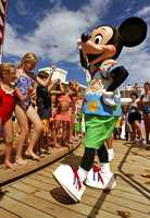 Several people said Mickey is teaching the kids the Cupid Shuffle aboard one of the Disney cruises.