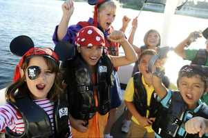 Young pirates return to land with bags of treasure.