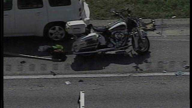 A Polk County deputy was injured by a car while conducting a traffic stop on eastbound Interstate 4 Friday morning.