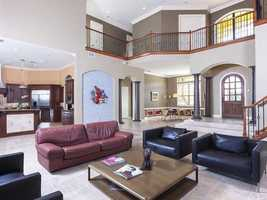 Spacious living space with an overlooking balcony.