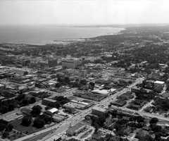 """Pensacola (Escambia County): The name is a derivations of Pansfalaya, an Indian tribe. The Choctaw called them the """"long-haired people.""""  The picture is a 1960s aerial view of Pensacola."""