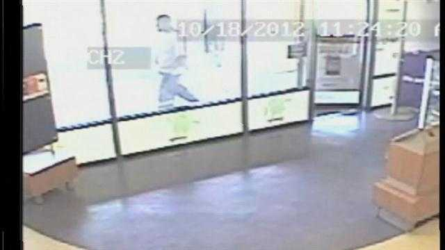 Police released surveillance video from the MetroPCS store next door to the salon in Casselberry.