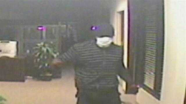 A man is seen on surveillance video robbing an Orange bank on South Orlando Avenue in Winter Park.