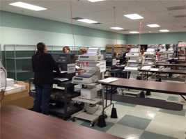 Counting Absentee Ballots at the Orange County Supervisor of Elections Office.