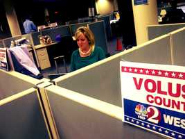 WESH 2's Cara Moore works a story in the newsroom.