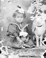 Hazel Harrell poses with her cat and goat in Madison County during the 1870s.