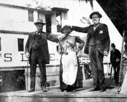 """Aunt Scilla standing beside the """"Astatula"""" at the Silver Springs dock in the 1890s.  She made a living telling the legend of the Bridal Chamber. The story was a romanticization of a spring by the legend of a lover's suicide pact."""