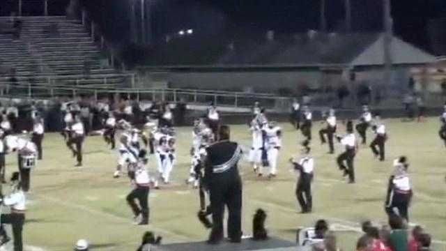 High school players refuse to leave field for band