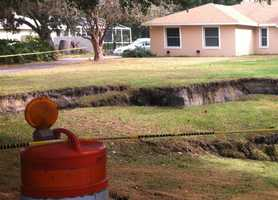 Another large sinkhole opened up a few miles away in May.