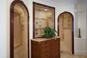 Double-arched entrances to the bathroom.