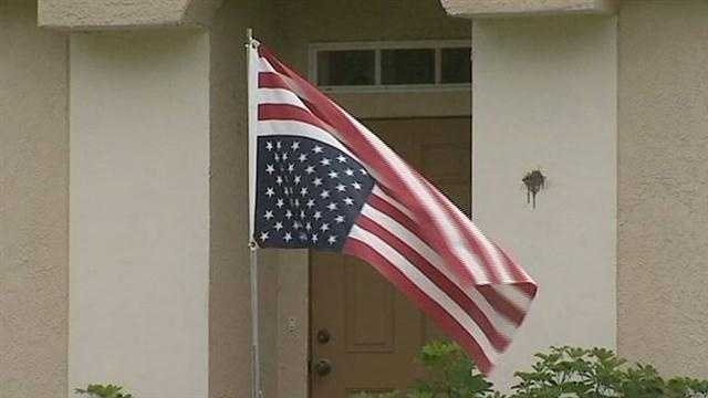 Man flies flag upside down in Palm Bay