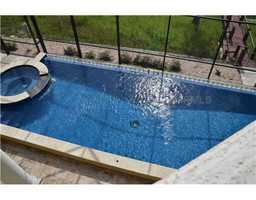 Cool down in the pool or jacuzzi inside the fenced-in patio area.