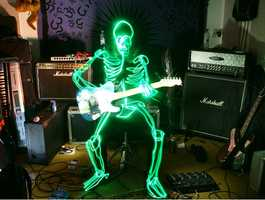 Light-painting- Helsinki artist Janne Parviainen creates light-painting photographs by using different light sources during varying exposure times, ranging from a few seconds to several hours. Janne places his skeletons in everyday situations as this cool guitarist demonstrates.