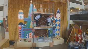 Over at Disney's Contemporary Resort, a 17 foot tall gingerbread holiday tree decorated with ornaments, candy canes and gifts is on display for guests.