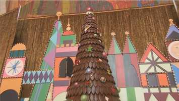 It took 136 pounds of honey, 211 pounds of flour, 101 eggs, 1 pound of sugar syrup, 98 pounds of icing, 151 pounds of chocolate and more than 2,000 gingerbread shingles to create the tree.
