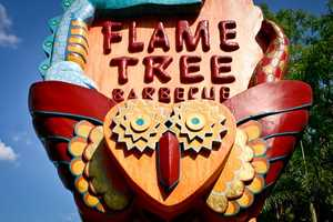 If you're familiar with Disney's Animal Kingdom Park then you know this interesting face can be found on the sign of the Flame Tree Barbecue.  Hungry now?