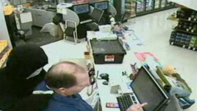 Walgreens robber holds gun to cashier's head